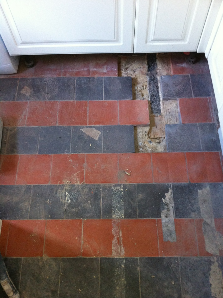 Old Quarry Tiles Before Repair and cleaning